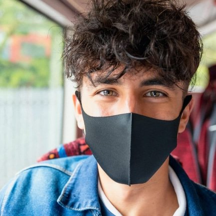 Man in blue shirt wearing a face mask