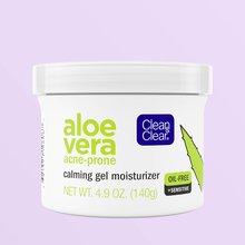 White jar of calming gel moisturizer over purple background