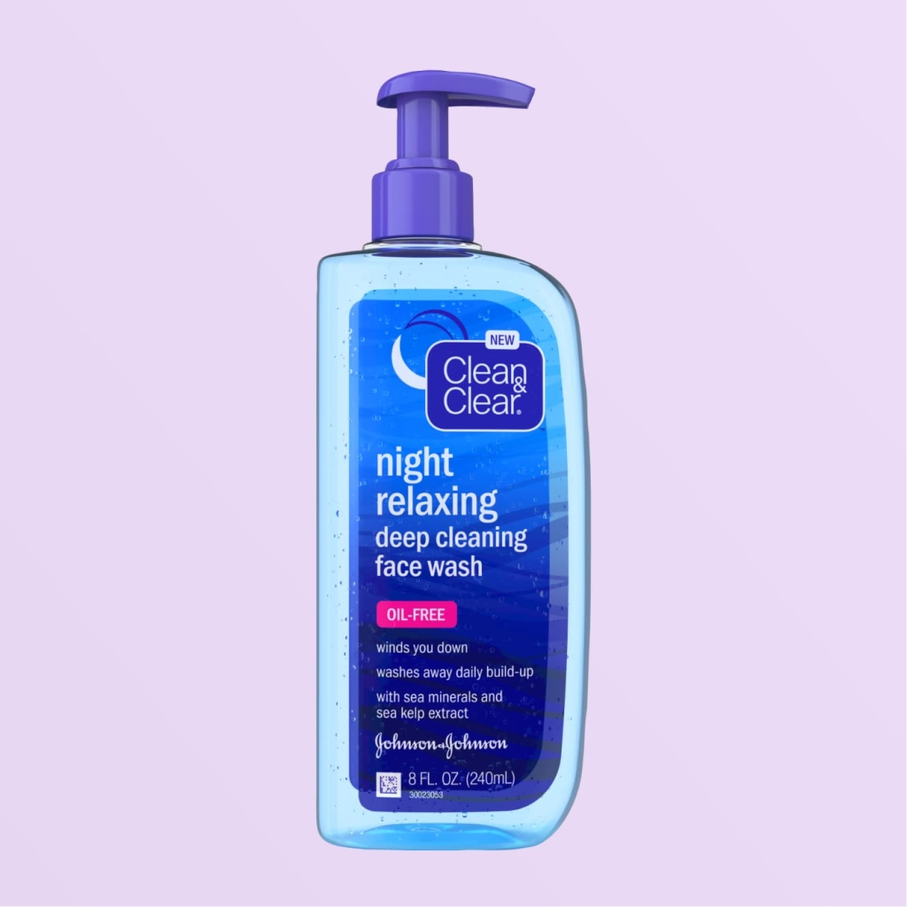 Clean & Clear Night Relaxing deep cleansing face wash, 8 fluid ounce clear blue bottle with purple pump top