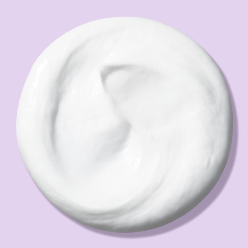 Circle blob of deep action cream cleanser in front of light purple background