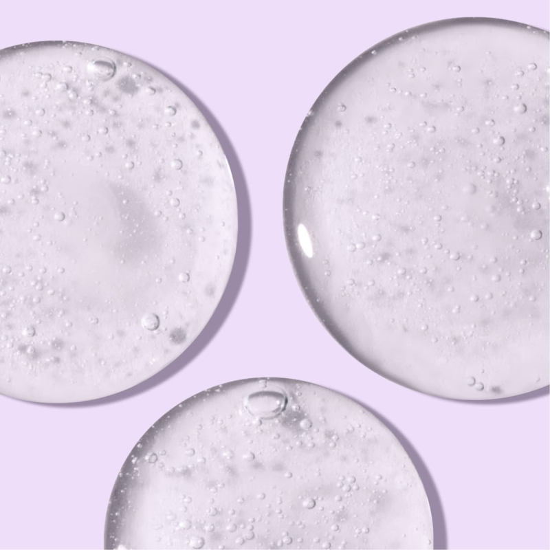 Glazed circles of Night Relaxing face wash in front of light purple background