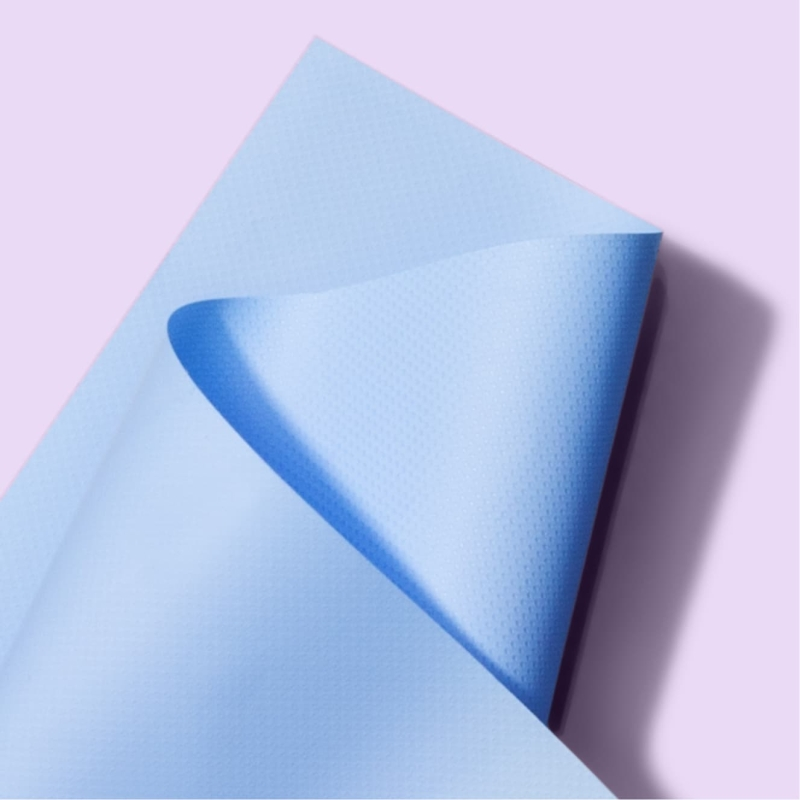 Close up of Clean & Clear blue oil absorbing sheet in front of light purple background